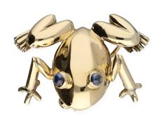 Yellow gold frog brooch with blue synthetic sapphire eyes