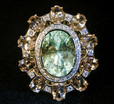 Exclusive golden ring with diamonds, morganites, and  IGI  certified  natural Emerald  6,90 ct.  Size 18. Total 9,64 grams