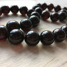 Baltic Amber, modified ball beads, dark cherry, 82,7 grams