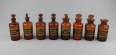 Lot of 8 small antique glass Pharmacists jars with labels ca. 1900.