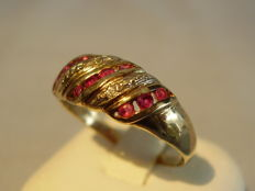 A gold ring with rubies 0.30 ct and diamonds 0.04 ct.