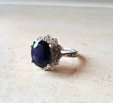 Entourage ring with royal Ceylon Iolite