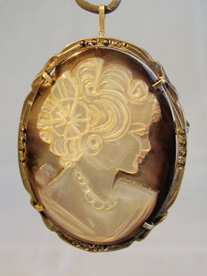 A pendant / brooch with hand-carved cameo made of natural mother of pearl