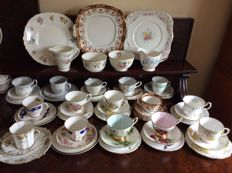 52 items Collection of fine china tea cups, milk jugs, sugar bowls, cake plates