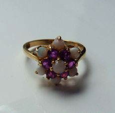 Gold ring with rubies and opals