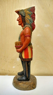 Classic wooden statue of a native American.