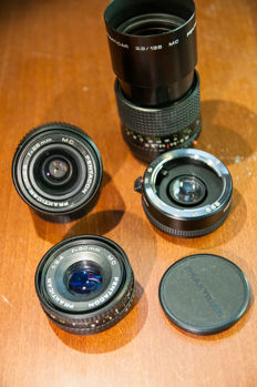 small collection of praktica B lenses 28 mm, 135 mm, 50 mm, 2 x teleconverter