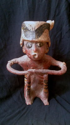 Pre-Columbian earthenware sculpture of a seated man with ceremonial headpiece - 240 mm