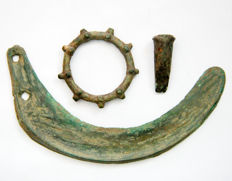 Collection of bronze objects: bronze amulet/pseudo money In the form of sun - 6x6 cm, bronze sickle - 17 cm  and small bronze socketed axe- 4 cm.  (3x)