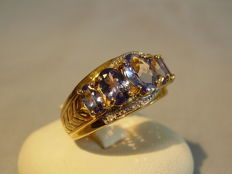 Golden band ring with 5 tanzanites of 2.50 ct and two diamonds 0.02 ct