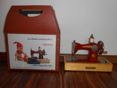 Antique children's sewing machine for doll clothes