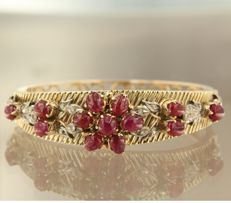 Gold and silver bangle with rubies and 12 single cut diamonds, approx. 0.28 carat in total