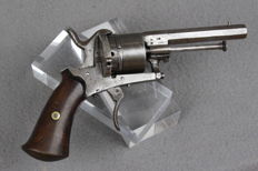 Pinfire revolver with wooden grip