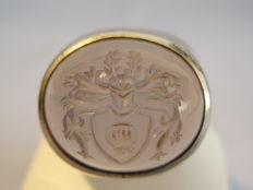 Large ring with light-blue chalcedony with engraved coat of arms