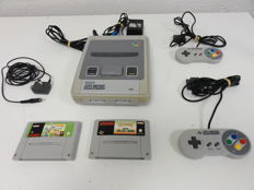 Super Nintendo with 2 games and controllers