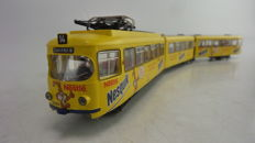 Roco H0 - 43187 - Double-articulated Duewag tram 'Nesquick'