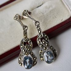 Sterling silver earrings with oval facet cut Aquamarine-coloured stones, approx. 7.4 x 6 mm and Marcasites, moving bottom.