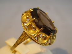 Golden ring with large 5 ct smoky quartz