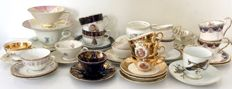 41 part English and German porcelain cup  and saucers