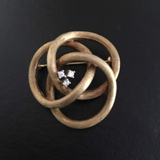 14kt yellow gold brooch set with diamonds