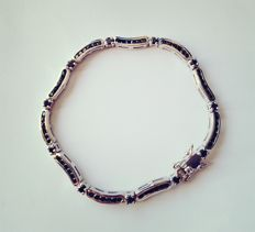 Platinum plated silver bracelet with 71 black Madagascar spinels.
