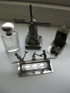 Silver puppet show, a perfume bottle, a back and forth and a mill.