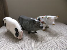 Set of 3 Royal Doulton& Fenton pigs,