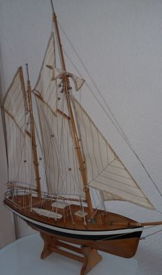 Decorative sailing boat complete with sails.