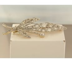 18 kt bi-colour gold branch brooch set with 200 rose and Bolshevik cut diamonds of approximately 6.00 carat in total
