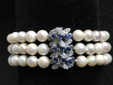 Bracelet with three strands of Akoya pearls, 5.8 mm, and 9 sapphires, 0.45 ct, with 14 kt white gold clasp