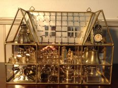 Vintage display case cabinet with brass edges and 19 miniatures