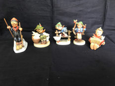 Lot with five multicoloured Hummel sculptures marked Goebel Germany