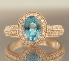 14 kt rose gold entourage ring with blue topaz and 47 brilliant-cut diamonds, approx. 0.50 carat in total; Ring size 16.5 (52) ****NO RESERVE PRICE****