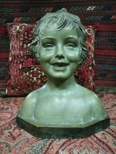 D.H. Chiparus (1886-1947) - Patinated terracotta sculpture of a happy child