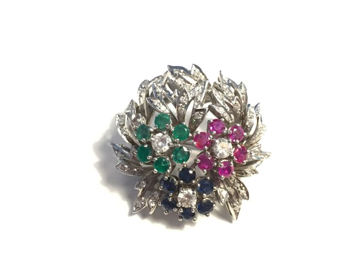 Golden brooch with gemstones