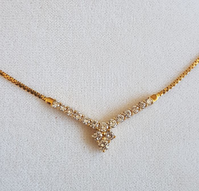 Pretty chain in yellow gold with fixed pendant set with diamonds of 1 ct