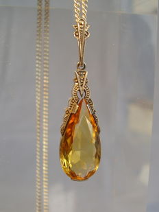 A signed pendant with an elongated faceted citrine droplet of approx. 4 ct on a silver necklace.