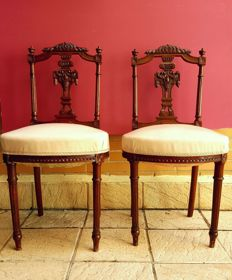 Pair of chairs carved in mahogany. Upholstered in flesh colour, 19th century.
