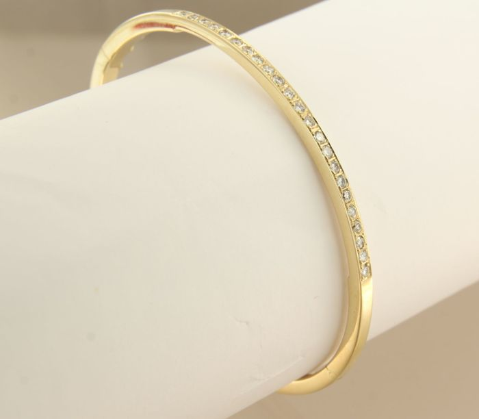 14k yellow gold hinge bracelet set with 23 brilliant cut diamonds, inner size 6 x 5.3 cm