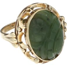 14k Yellow gold ring set with oval cut nephrite - Ring size: 18.5 mm.