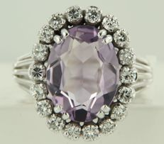 18k white gold entourage ring set in the centre with an oval cut amethyst and 18 brilliant cut diamonds, approx. 0.81 carat in total ****NO RESERVE PRICE***