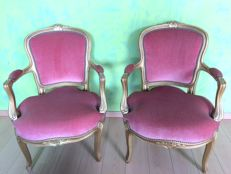 Pair of wing chairs in gilded wood - France - 19th century
