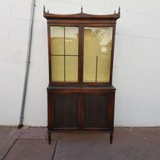 Big English wardrobe display cabinet made by hand with details in iron and leather, first half of the 20th century.