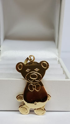14 kt yellow gold pendant of a  teddy bear set with two small  diamonds