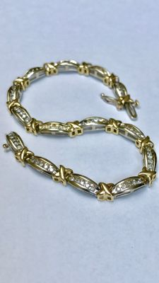"Gold bicolour bracelet with 70 brilliant cut diamonds. Total approx. 1.40 carat ""No Reserve Price"" Length 20 cm"