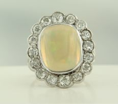 White gold 14 kt entourage ring set with a central opal and entourage Bolshevik cut diamonds
