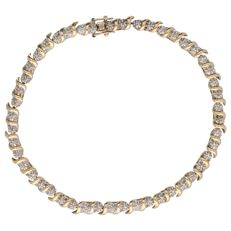 14 kt. Bi-colour yellow/white gold fantasy link bracelet set with 48 diamonds of approx. 0.24 ct in total - Length: 19.5 cm
