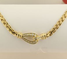 18 kt Yellow gold necklace set with 17 brilliant cut diamonds, approx. 0.59 carat in total, necklace length 42 cm long.