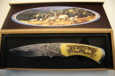 Very Fine Stainless Steel with bone carving in handle of Stag and deer