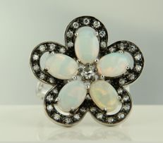 14 kt white gold ring in the shape of a flower, set with opal and Bolshevik and single cut diamonds, ring size 17.25 (54).